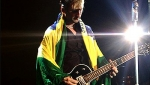 Martin draped in the flag of Brazil
